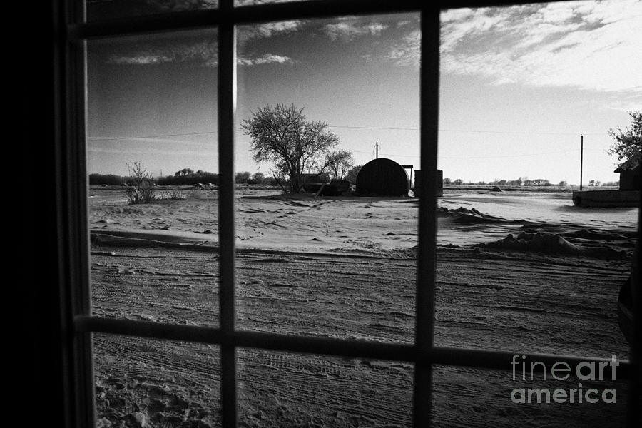 looking out through door window to snow covered scene in small rural village of Forget Saskatchewan  Photograph  - looking out through door window to snow covered scene in small rural village of Forget Saskatchewan  Fine Art Print