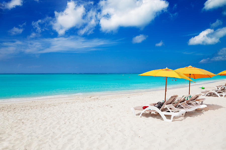 Lounge Chairs And Yellow Umbrellas Photograph