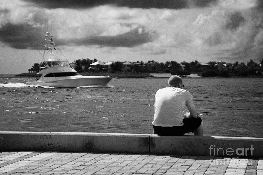 Man Fishing On Mallory Square Seafront Key West Florida Usa Photograph