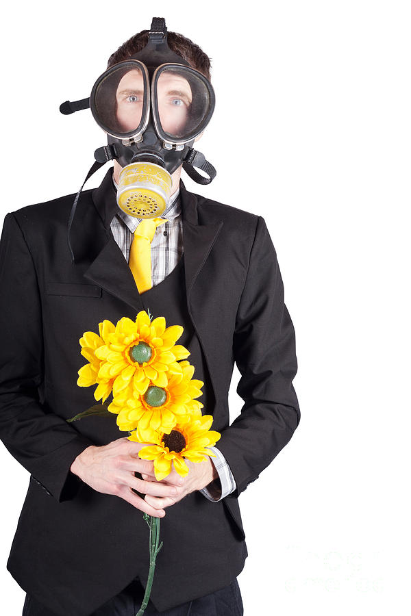 Man In Gas Mask With Flowers Photograph