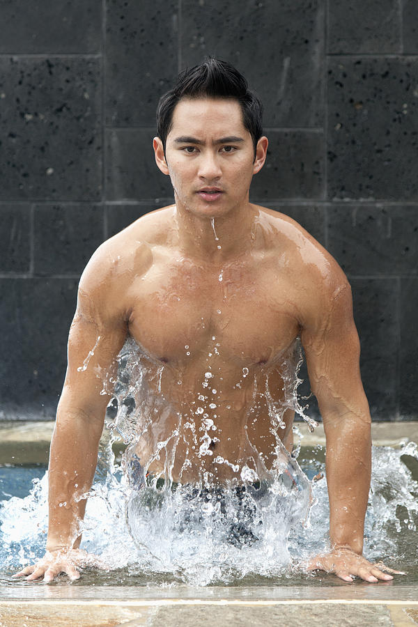 Asian Photograph - Man In The Pool by Brandon Tabiolo