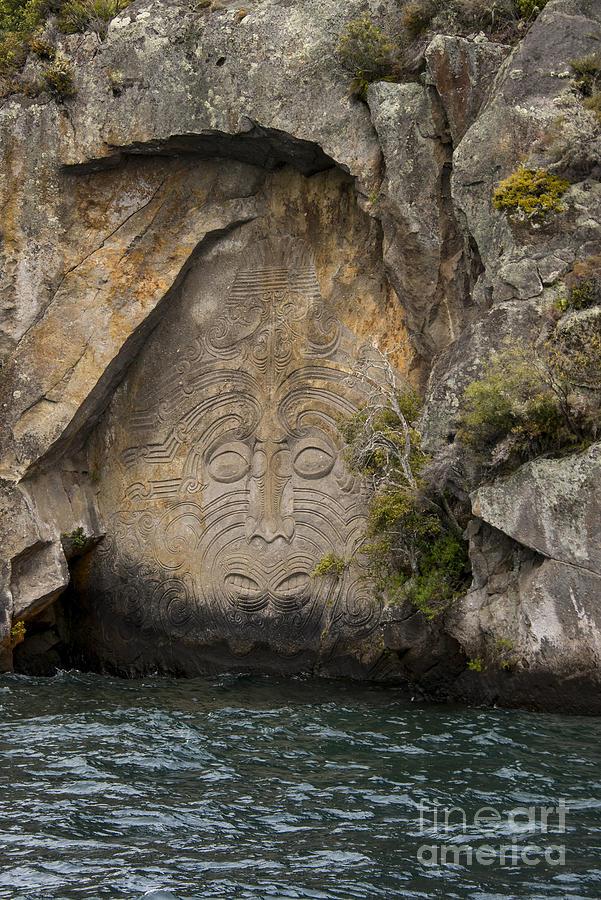 Maori rock carving photograph by bob phillips