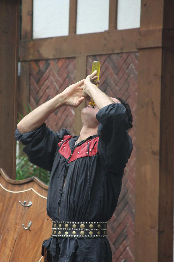 Maryland Photograph - Maryland Renaissance Festival - Johnny Fox Sword Swallower - 121272 by DC Photographer