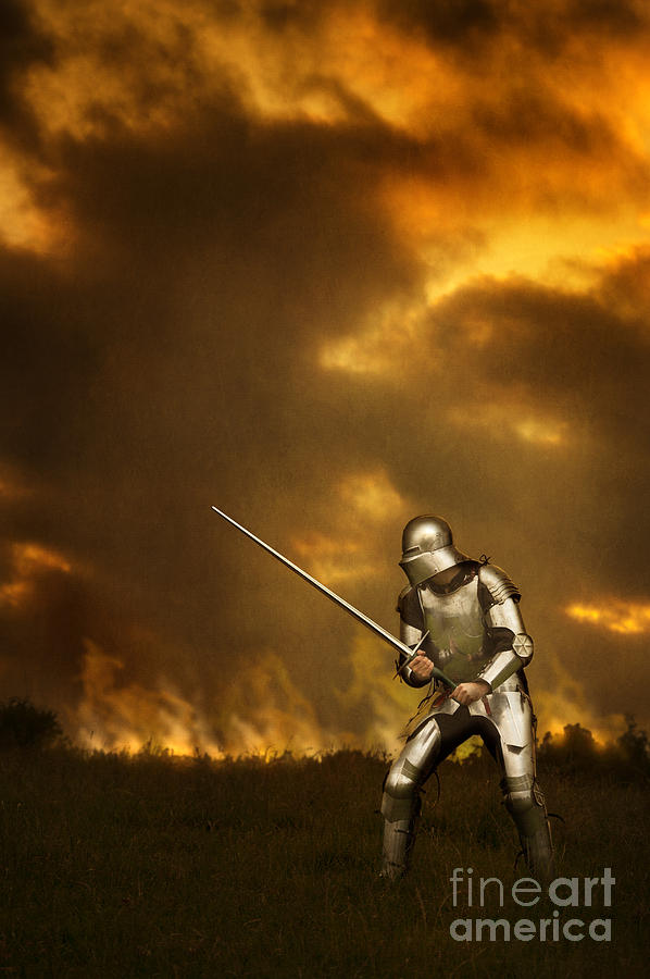 Medieval knight in armour on a battlefield photograph