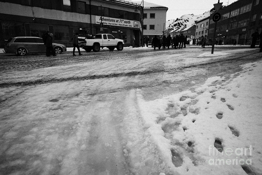melting ice and snow on street surface holmen Honningsvag finnmark norway europe Photograph