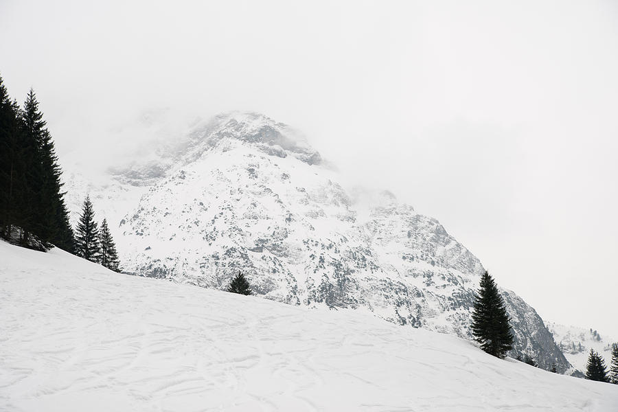 Minimalism Photograph - Minimalist Snow Landscape - Mountain And Trees In Winter by Matthias Hauser