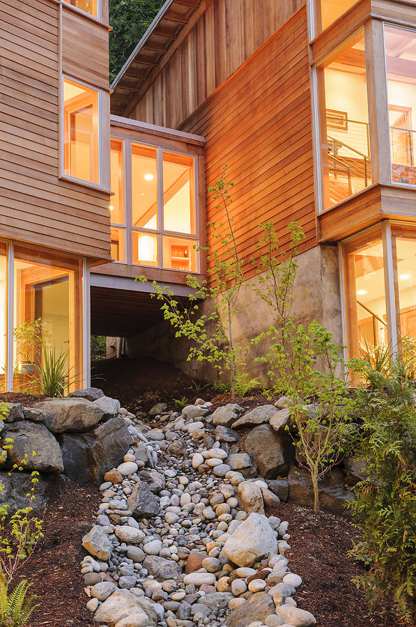 Modern House And Rocky Creek Photograph