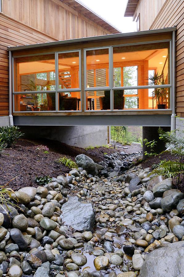 Modern House Over Rocky Creek Photograph