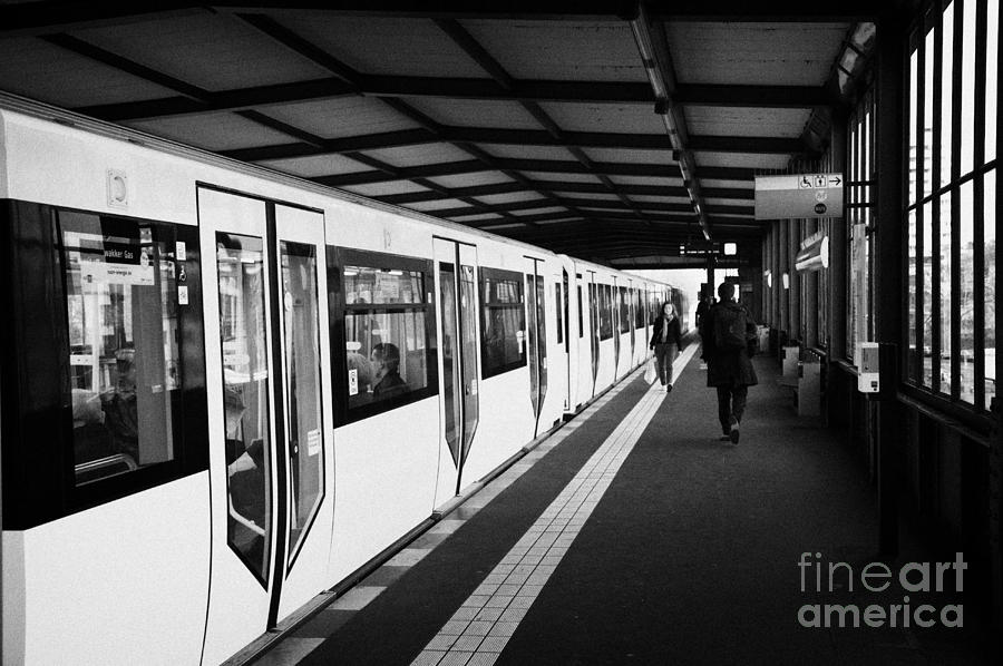 modern yellow u-bahn train sitting at station platform Berlin Germany Photograph  - modern yellow u-bahn train sitting at station platform Berlin Germany Fine Art Print
