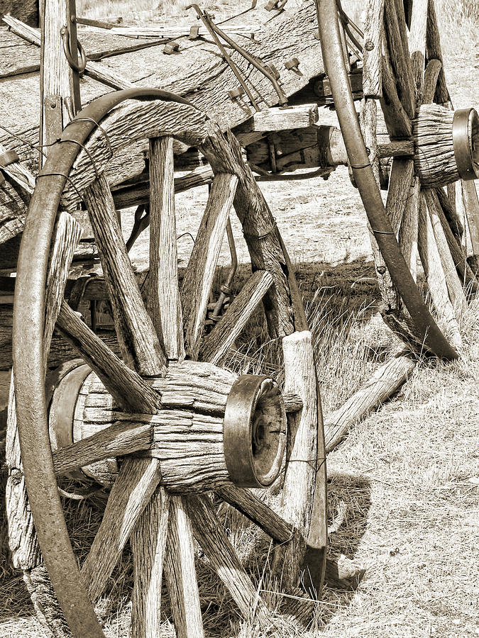 Montana Old Wagon Wheels In Sepia Photograph  - Montana Old Wagon Wheels In Sepia Fine Art Print
