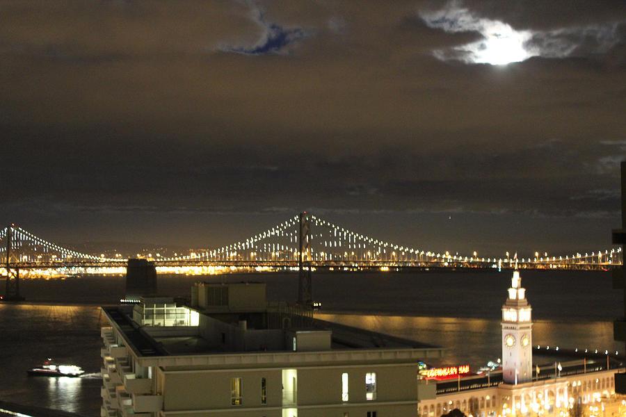 Cityscape Photo Photograph - Moon Burst Over San Francisco Oakland Bay Bridge by Ron McMath