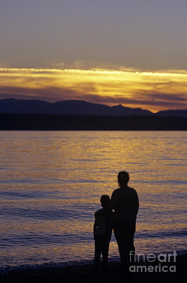 Travel Photograph - Mother And Daughter Holding Each Other Along Edmonds Beach At Su by Jim Corwin
