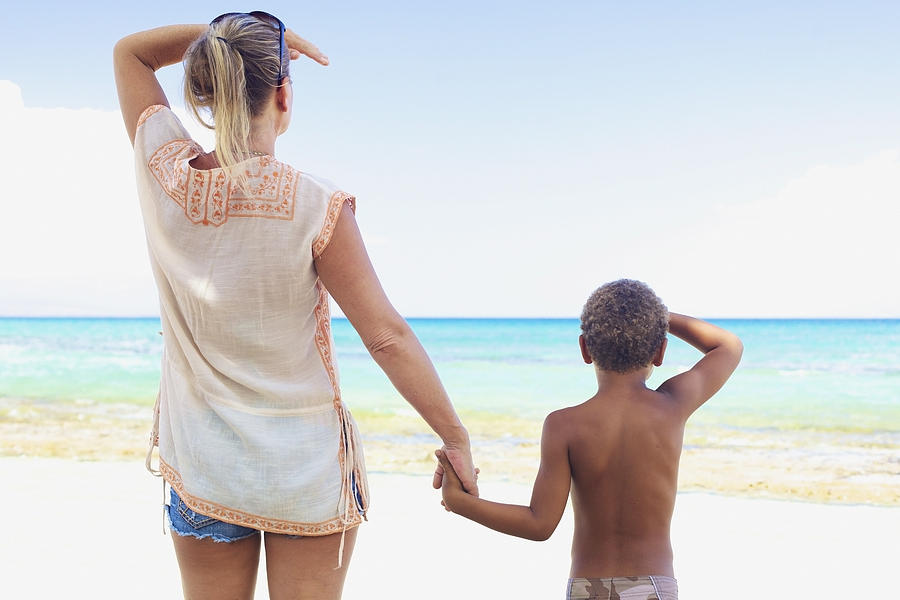 Mother And Son At Beach Photograph