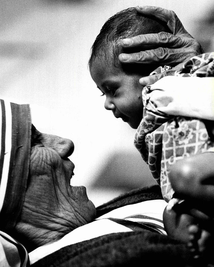 Classic Photograph - Mother Teresa Holds Baby by Retro Images Archive