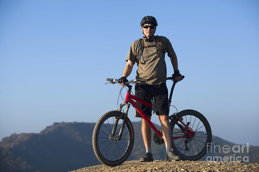Active Photograph - Mountain Biker by Mike Raabe