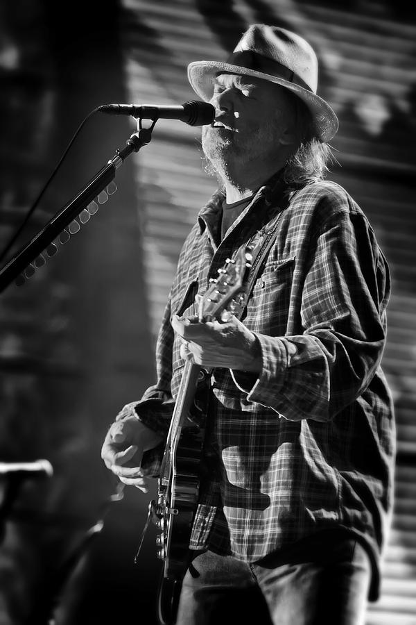 Neil Young Singing And Playing Guitar In Black And White Photograph