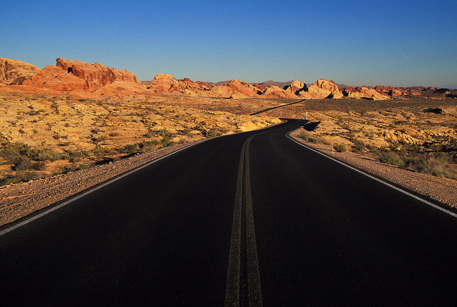 Empty; Absence; Desert Road; Nevada; Desert; Highway; Landscape; Rock Formation; Tranquility; Remote;  Scenics; Beauty In Nature; Travel; No People; Horizontal; Outdoors; Day; Copy Space Photograph - Nevada. Desert Road by Anonymous