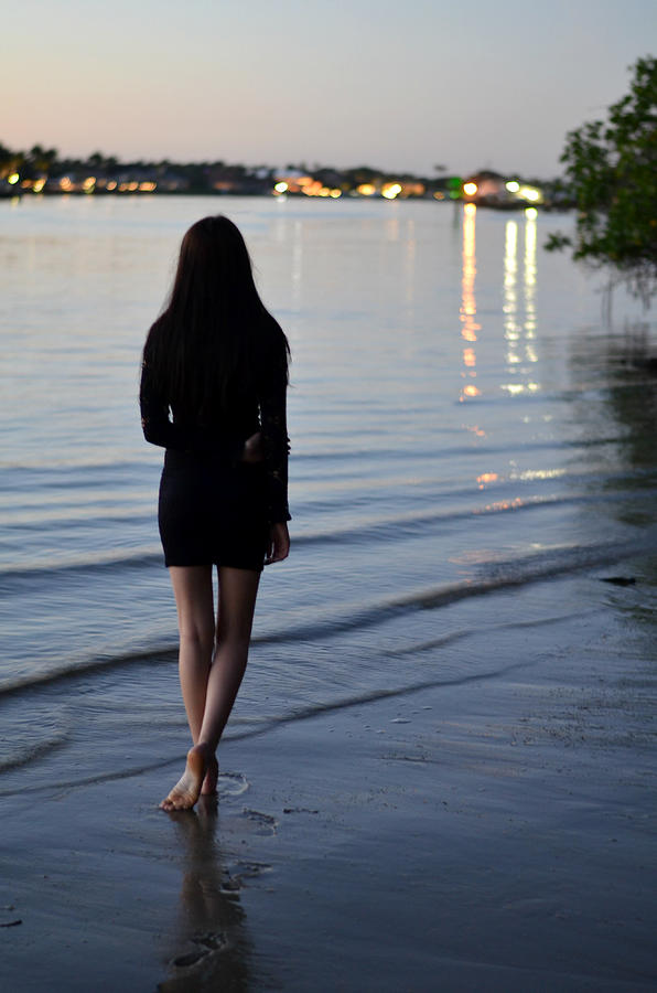 Woman Walking Beach Seashore Footprints Serene Landscape Night Sunset Gloaming City Lights Island Sand Waves Bare Legs Little Black Dress Tranquil Meditative Quiet Peaceful One Solo Dark Hair Reflection Shadows Barefoot Foot Feet Sole  Book Cover Laurarama Laura Fasulo Model Blue Blues Gray Grays Pink Sky Water Jupiter Island Florida On The Waterfront River Moody Atmospheric Cinematic Drama Dramatic Iphone Samsung Galaxy Phone Cases Case No Man's Land Photograph - No Mans Land by Laura Fasulo