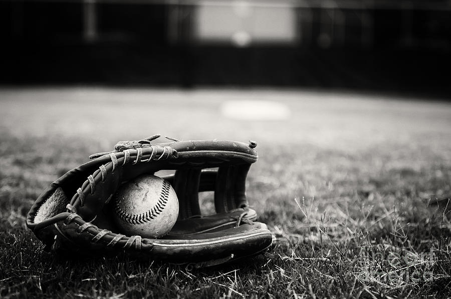 Old Baseball And Glove On Field Photograph