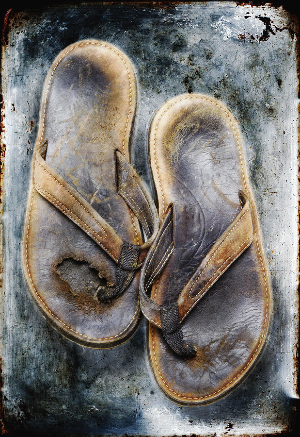 Age; Art; Broken; Brown; Close-up; Comfort; Conceptual; Cracked; Detail; Flip Flops; Forgotten; Jagged; Memory; Old; Pair; Past; Poverty; Relax; Rough; Shoes; Simple; Slippers; Surreal; Tan; Texture; Two; Vertical; Weathered; Worn; Straps; Destroyed; Step; Journey; Travel; Adventure; Friend; Companion; Life; Lived; History; Beach Life; Lounge Photograph - Old Flip Flops by Skip Nall