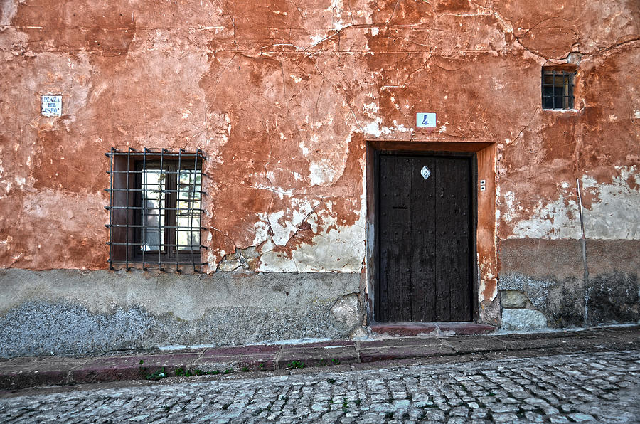 Old House Over Cobbled Ground Photograph