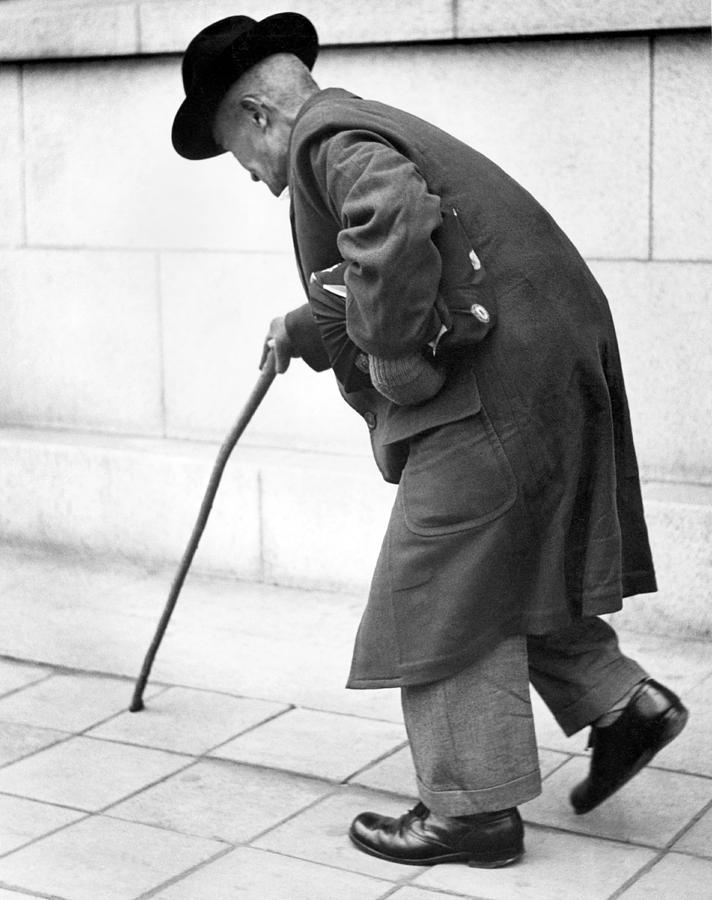 Old Man Walking With A Cane Photograph by Underwood Archives