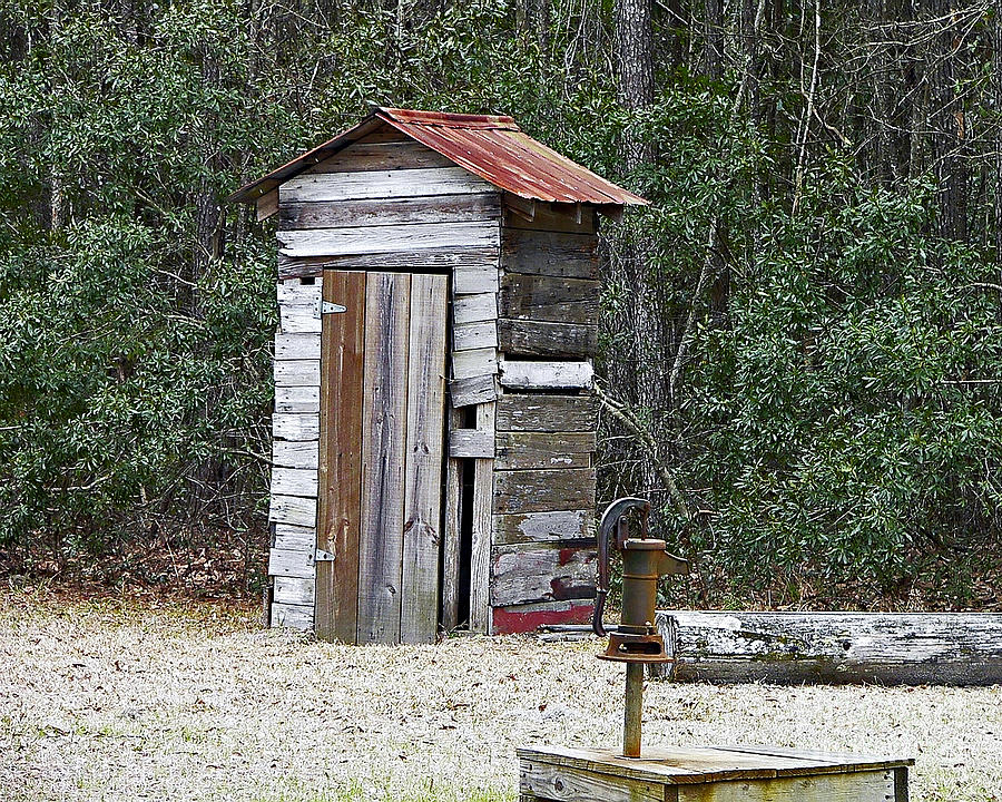 Old Time Outhouse And Pitcher Pump Photograph