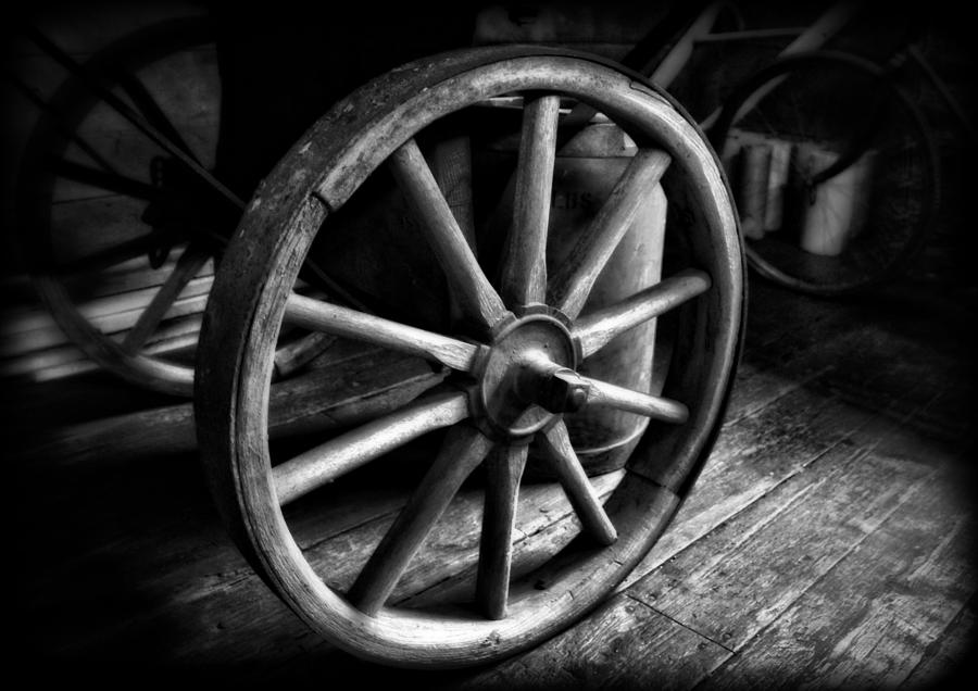 Old Wagon Wheel Black And White Photograph by Dan Sproul