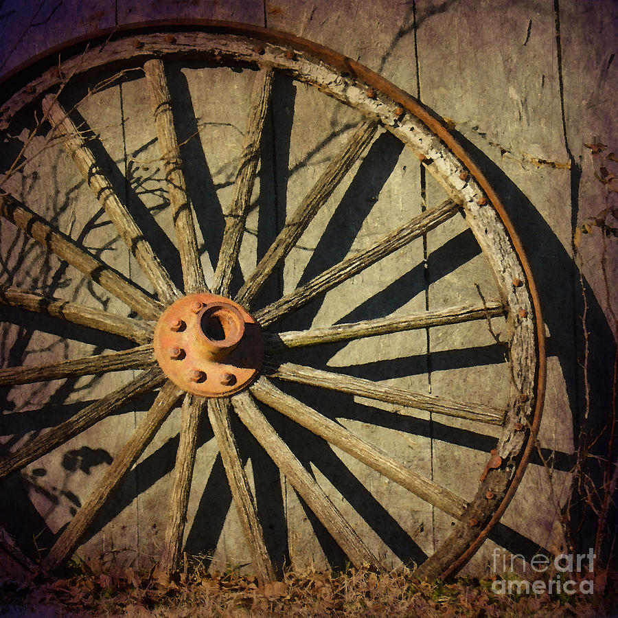 Old West Photograph - Old West Wagon Wheel by Betty LaRue