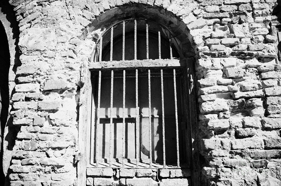 Old Wooden Framed Window With Weathered Steel Bars In Red Brick Building With Plaster Removed Krakow Photograph