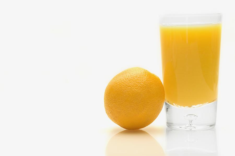 Orange And Orange Juice Photograph