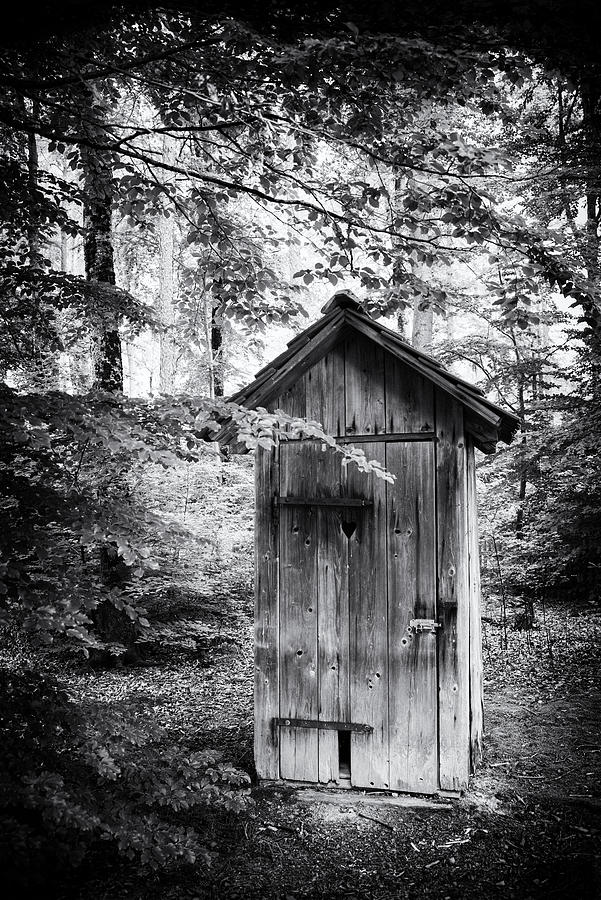 Outhouse In The Forest Black And White Photograph By