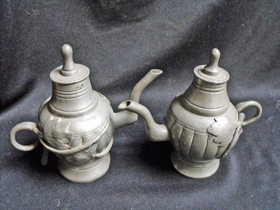 Pair Of Decorated Pewter Teapots Mixed Media  - Pair Of Decorated Pewter Teapots Fine Art Print
