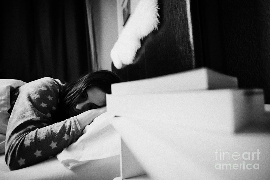 Paperback Books On Bedside Table Of Early Twenties Woman In Bed In A Bedroom Focus On Woman Photograph  - Paperback Books On Bedside Table Of Early Twenties Woman In Bed In A Bedroom Focus On Woman Fine Art Print