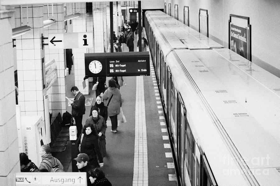 Berlin Photograph - passengers along ubahn train platform Friedrichstrasse Friedrichstrasse u-bahn station Berlin by Joe Fox