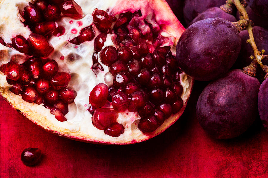 Pomegranate And Red Grapes Photograph