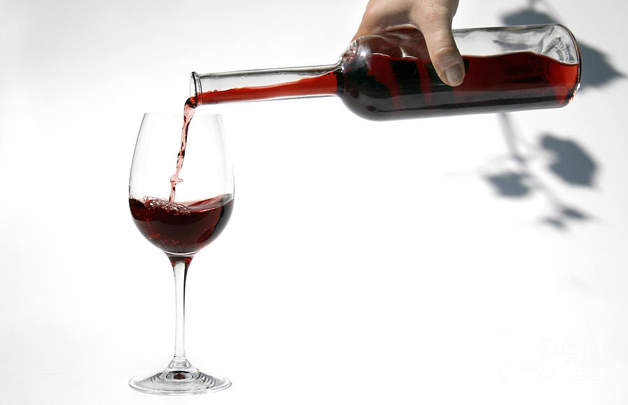 Pouring Red Wine Into Glass Photograph