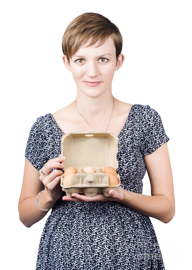 Pregnant Young Woman Displaying A Box Of Eggs Photograph