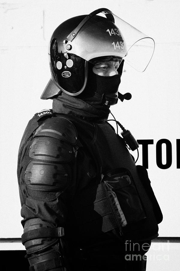 Northern Photograph - Psni Officer In Ninja Riot Geat On Crumlin Road At Ardoyne Shops Belfast 12th July by Joe Fox