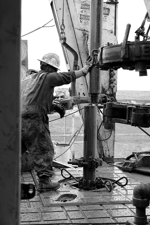 Oil Rig Photograph - Putting It Together by Jason Drake