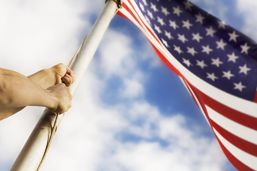 Raising An American Flag Photograph