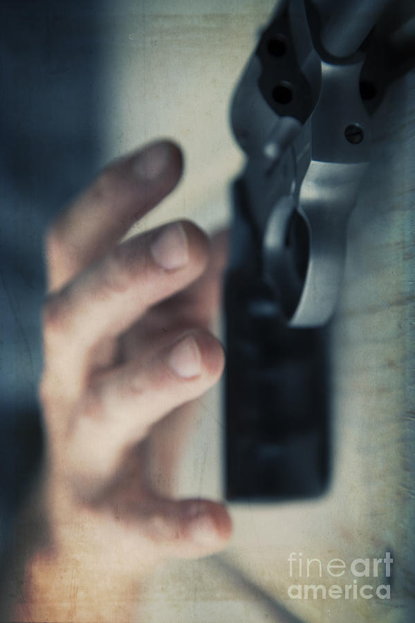 Angle Photograph - Reaching For A Gun by Edward Fielding