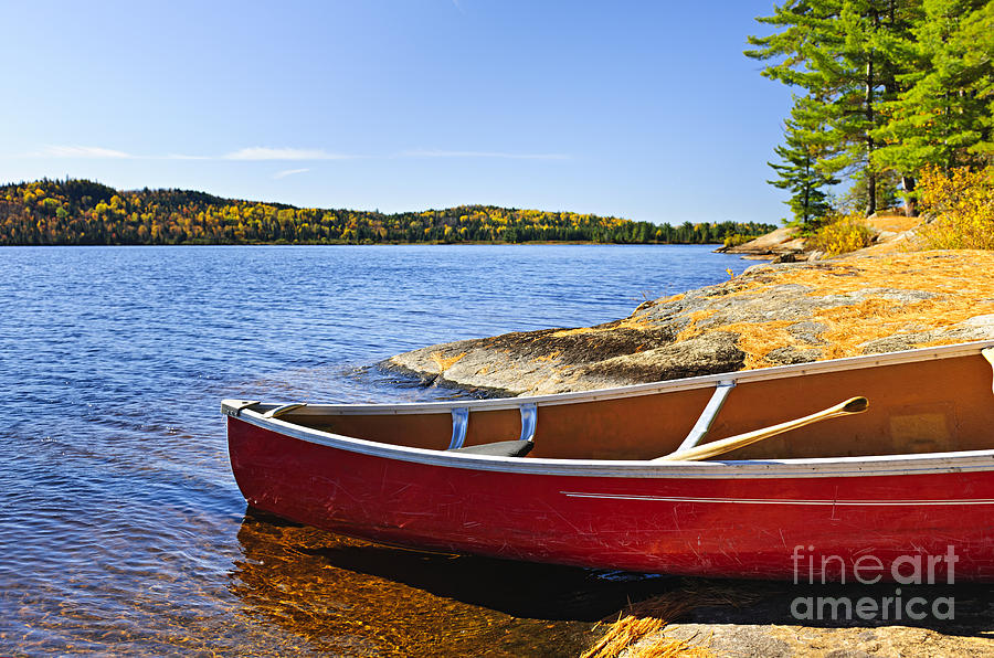 Red Canoe On Shore Photograph