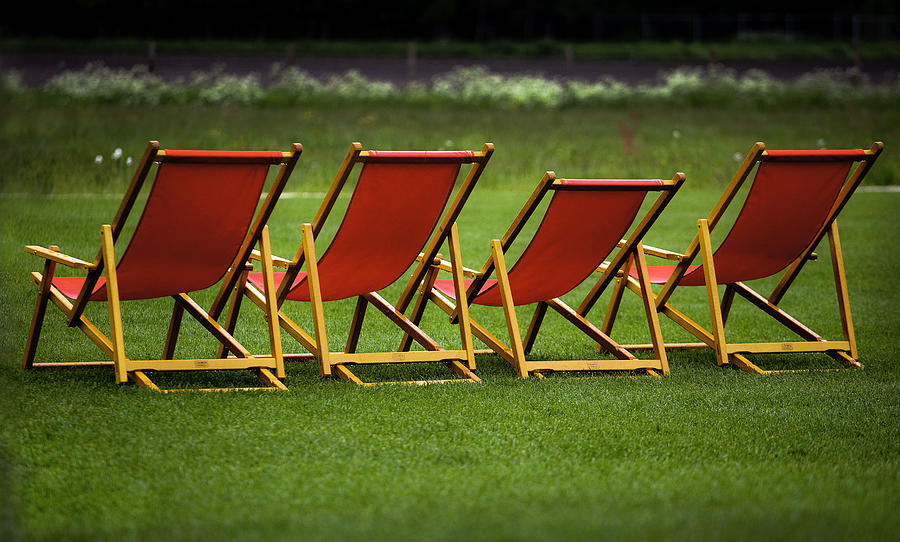 Red Deck Chairs On The Green Lawn Photograph