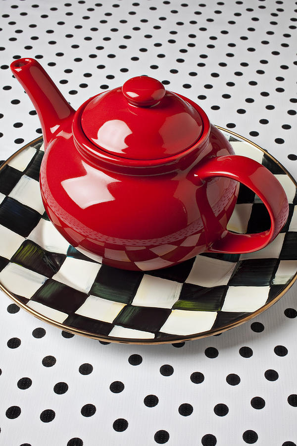 Red Teapot On Checkerboard Plate Photograph