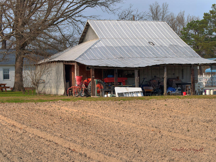 Popular Photograph - Red Tractor In A Tin Roofed Shed by Paulette B Wright