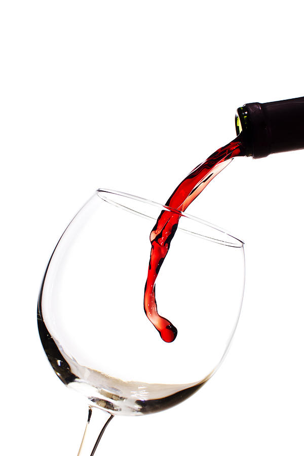 Red Wine Poured Into Wineglass Photograph