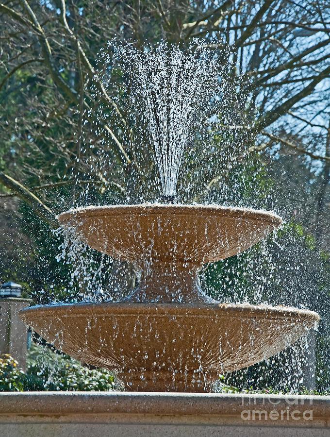Refreshing Fountain Of Water In Sunshine Photograph