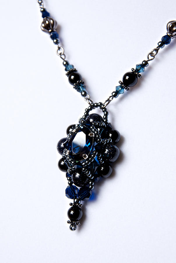 Regal Sapphire Pendant Necklace And Matching Earrings Set Photograph