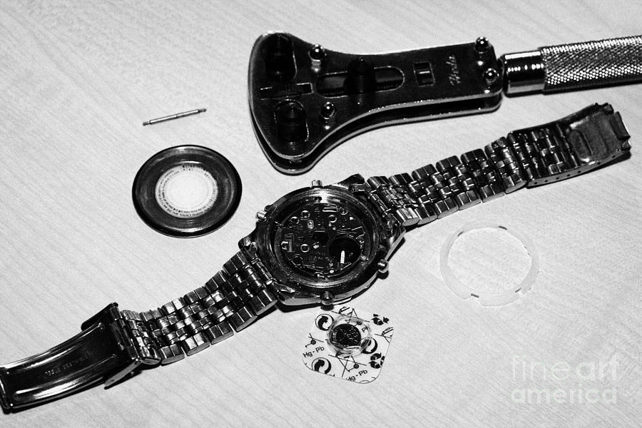 Replacing The Battery In A Metal Band Wristwatch Photograph